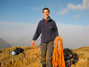Tom coiling rope on summit of y Lliwedd