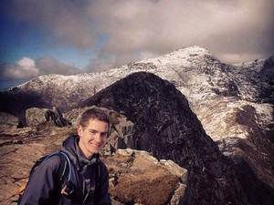Adrien on Y Lliwedd with Snowdon behind